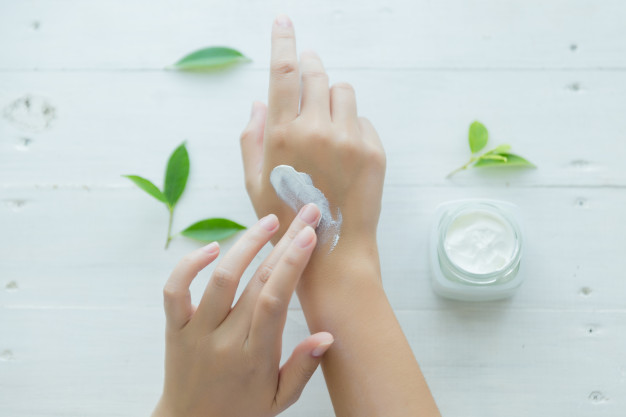 woman-holds-jar-with-cosmetic-cream-her-hands